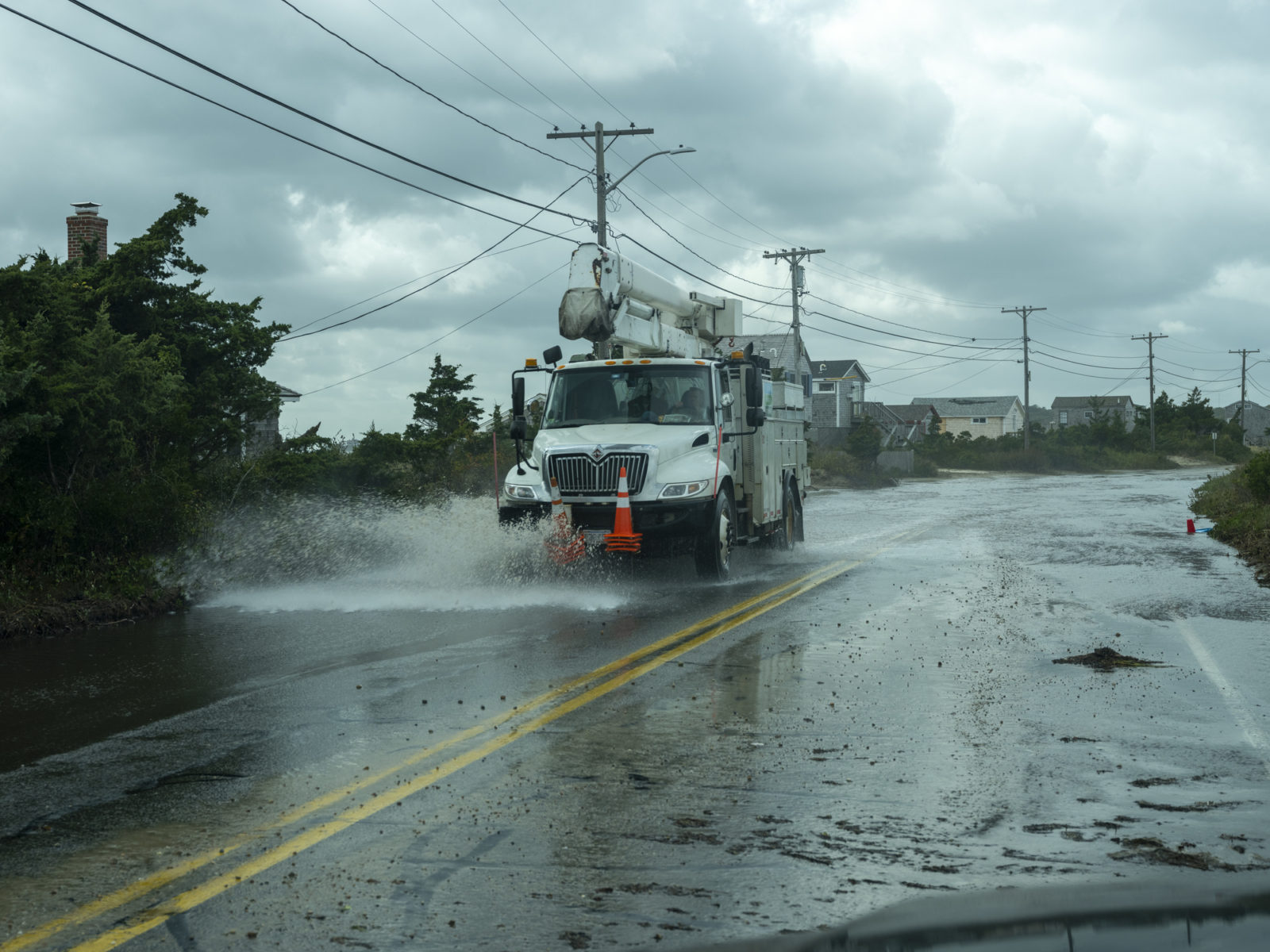 A picture of a utility truck driving in a storm, for a blog post on emergency preparation.