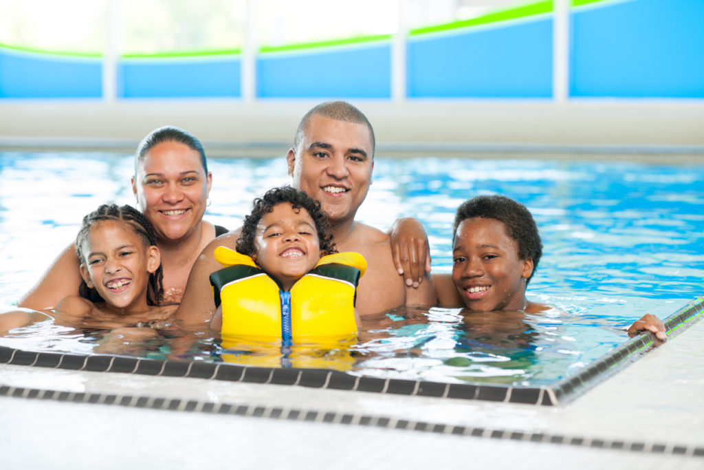 A family in a swimming pool. Make water safety a priority. LCA