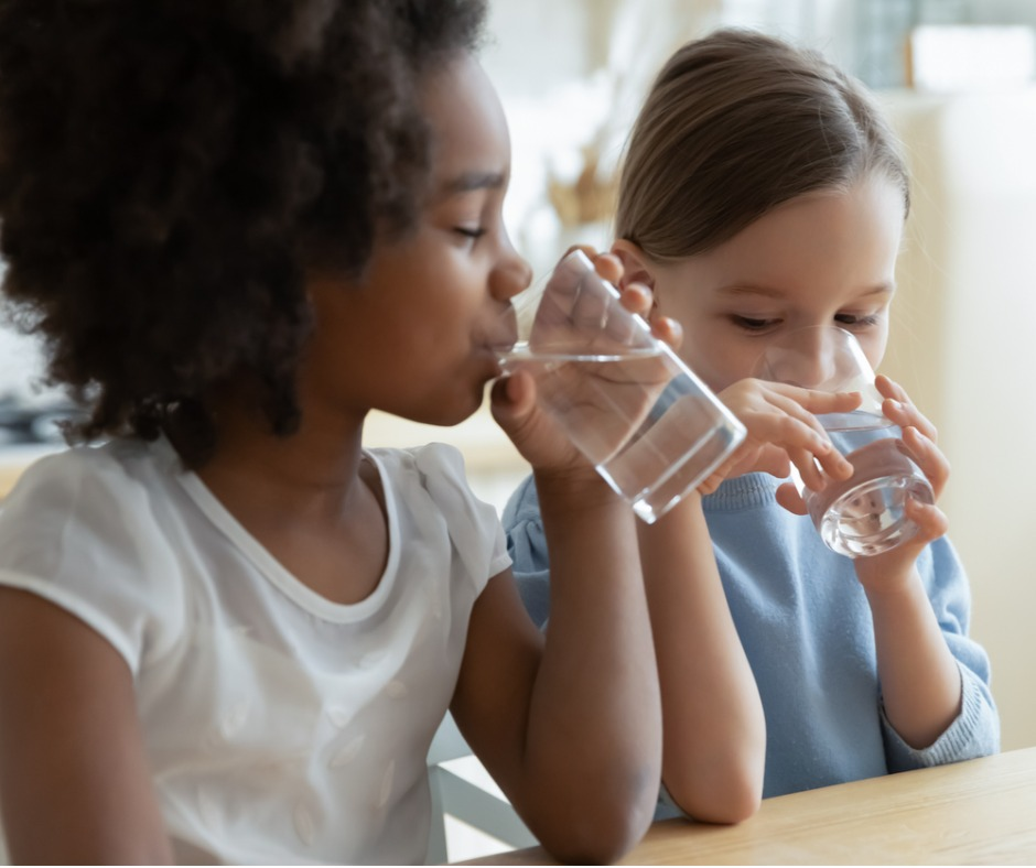 An image of two children drinking water to illustrate the importance of source water protection for National Prescription Drug Takeback Day.